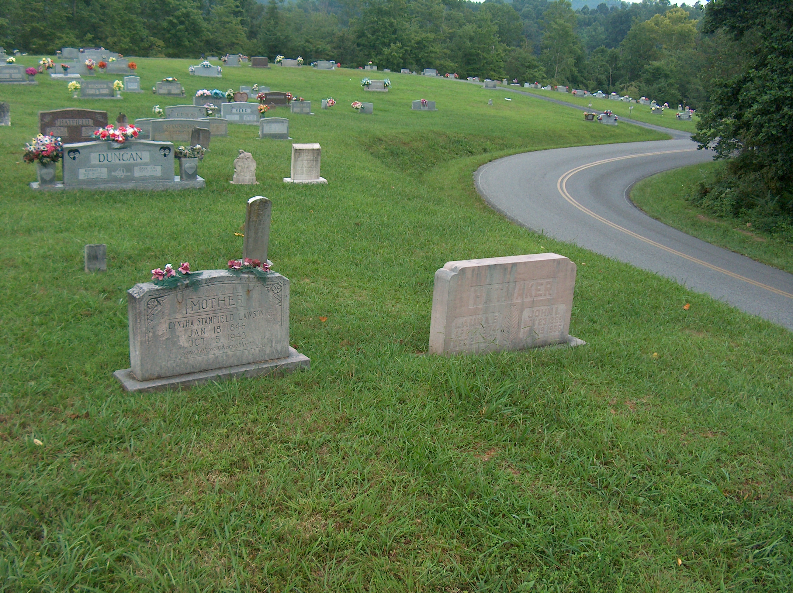 Sometimes family members are buried near each other. In this case, Cyntha is Laura's mother.